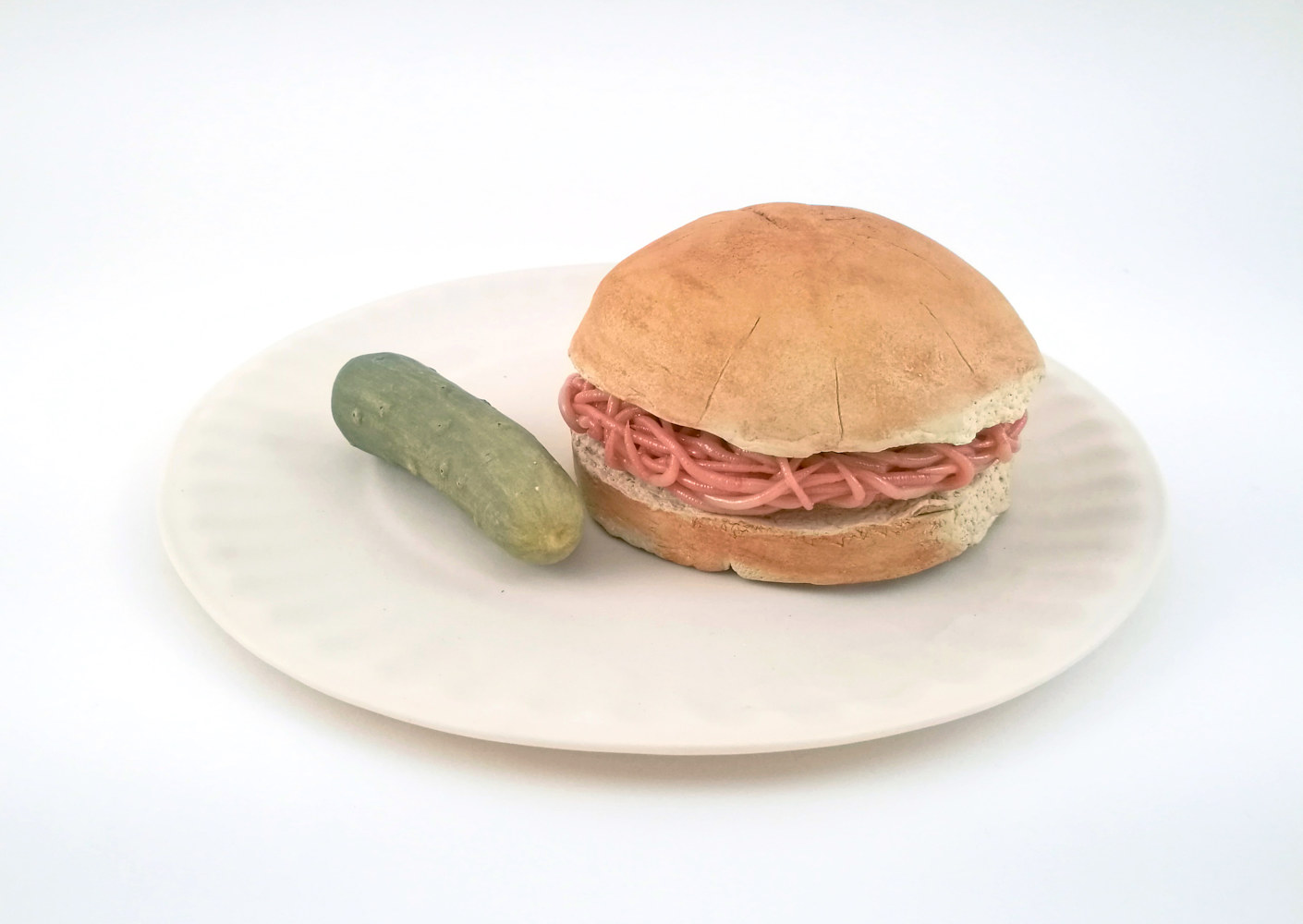 Drawing burger with pickle on a porcelain paper plate by Matthew  Dercole