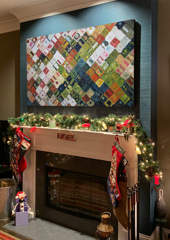 Some additional holiday cheer above the mantel by Robert Porazinski
