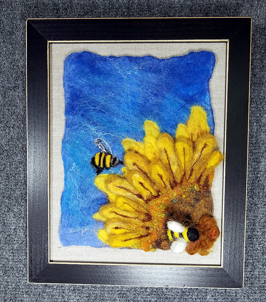 Bees in a Sunflower by Valerie Johnson