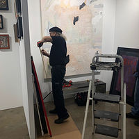 DonRio preparing the exhibition by Patricia Rain Gianneschi