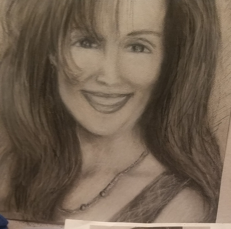Commissioned portrait in charcoal by Trish Becker