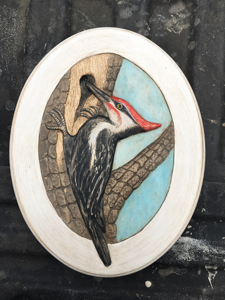 Painting Peliated wood pecker  carving  by Terry Ogle