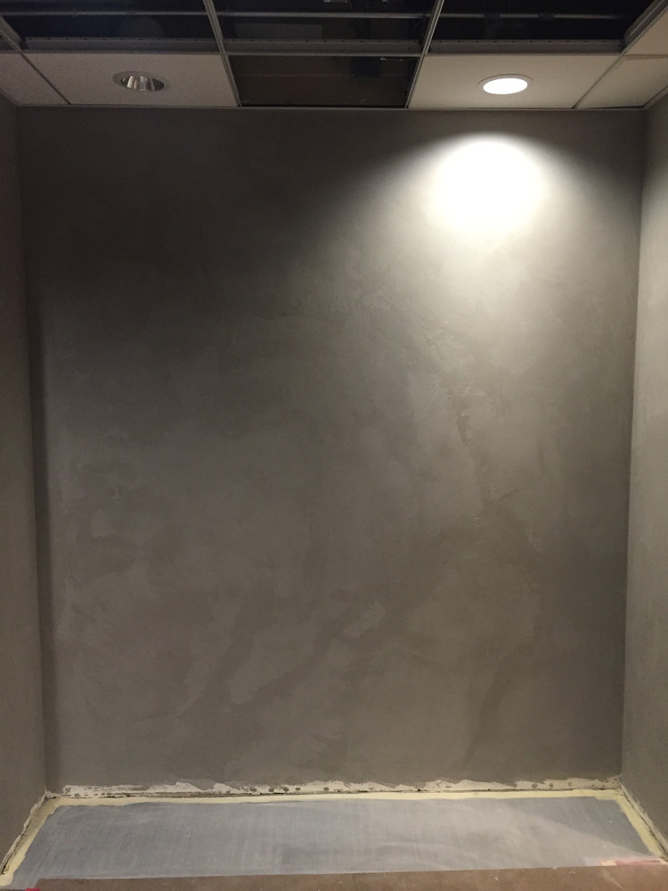 We usually are only able to document our surfaces while still in the midst of construction. Here, one of our walls done in a Firenze plaster finish is complete and ready for base. by Robert Milling