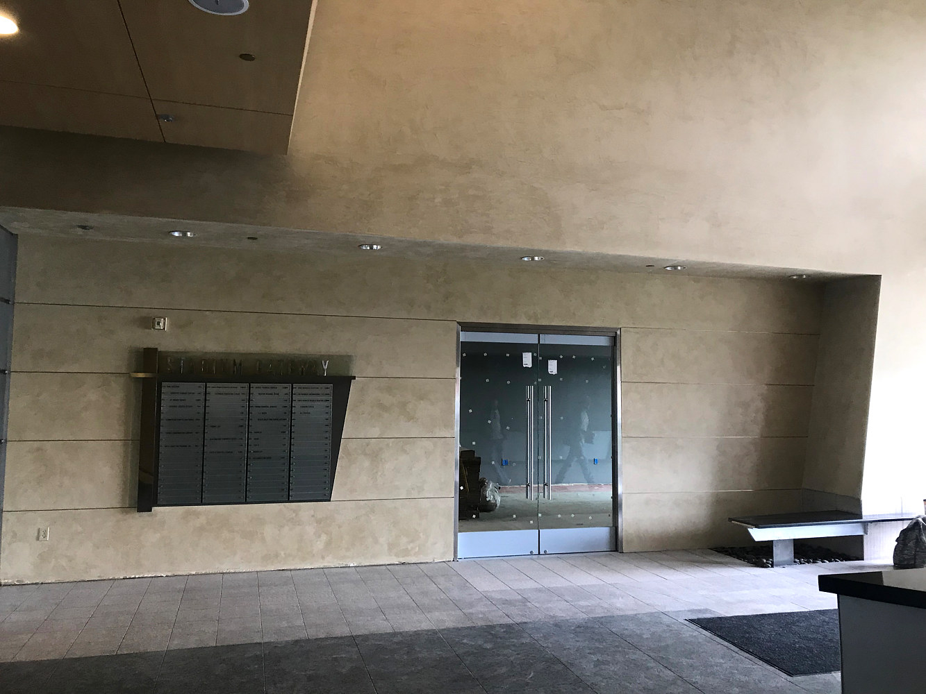These walls in a coomercial space near Anaheim stadium had been badly damaged during renovations. RMS matched the existing plaster to create a seamless transition for old to new.  by Robert Milling