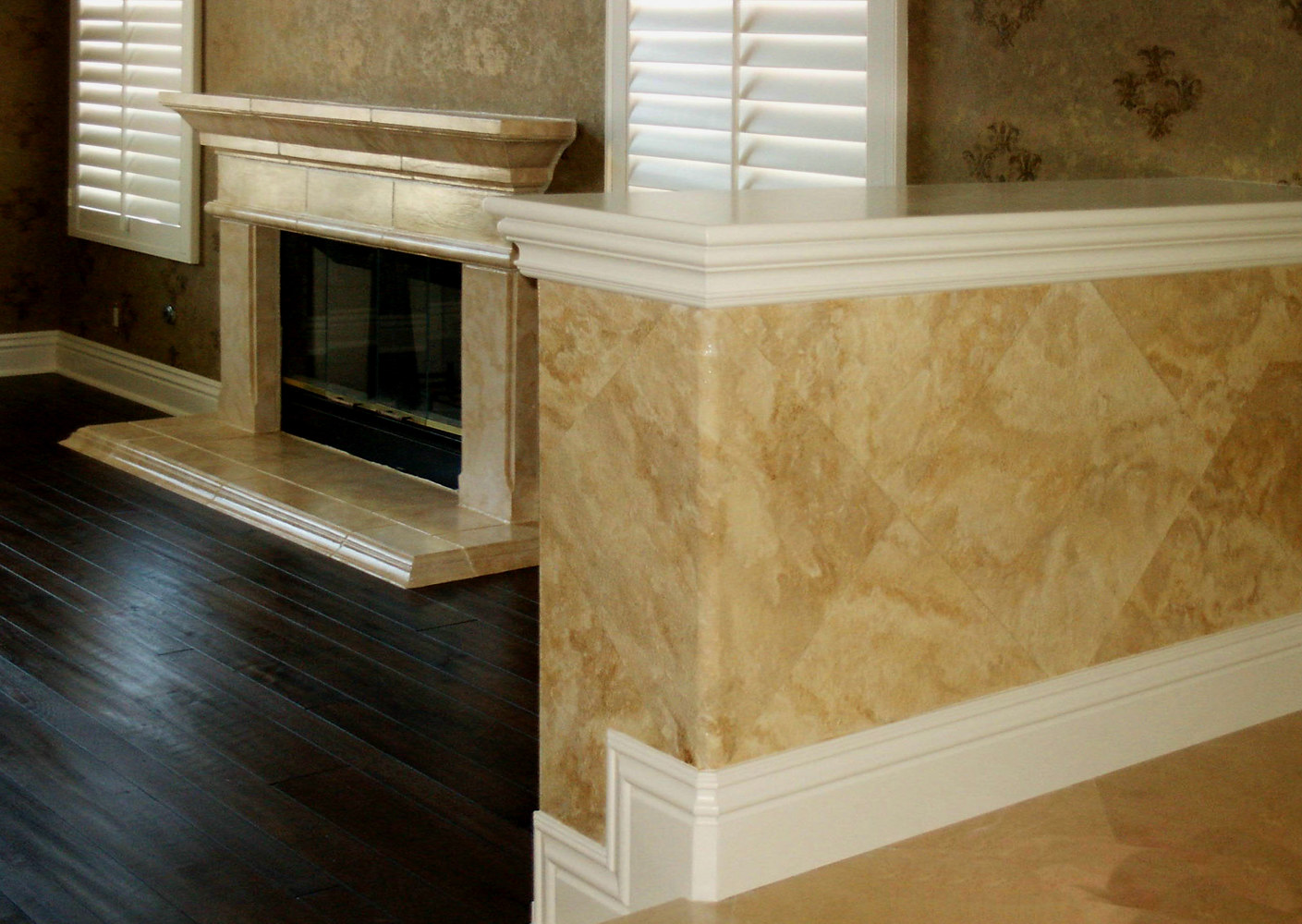 Pony wall and Fireplace in Travertine to Match Flooring Anaheim Hills by Robert Milling
