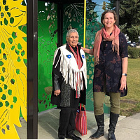 Senator Elder Nora Cummings and I, standing in front of the bus shelter we collaboratively designed with students.  by Tamara Rusnak