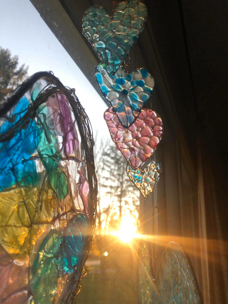 Front Window Hearts at Sunrise by Steven Simmons