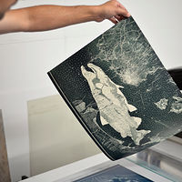Pulling print off printing press by Amie Rangel