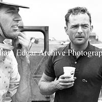 Photography [PH-SHLA7] Phil Hill flanked by Carroll Shelby and race mechanic Joe Landaker - Dillingham Field - Oahu - April 19, 1957 by William Edgar