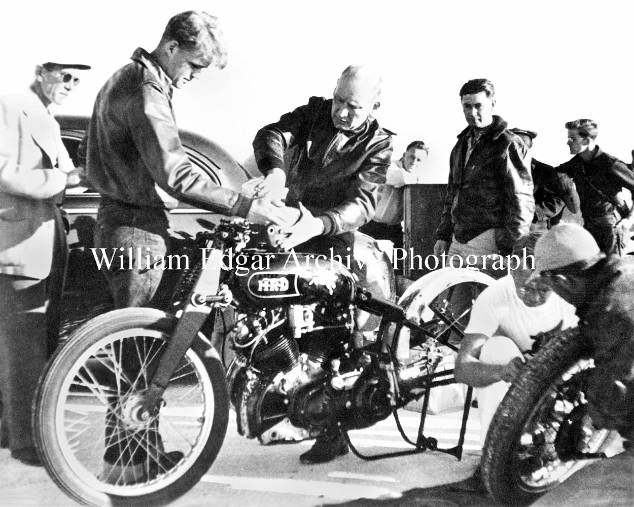 Photography [VH-JEAF8] John Edgar watches Rollie Free fuel the Edgar Vincent HRD at Bonneville - September 13, 1948 by William Edgar