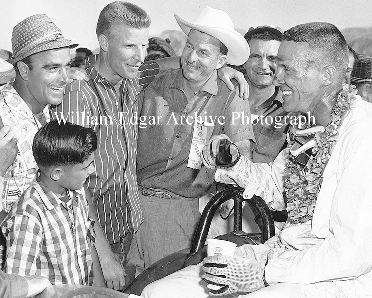 Photography [DG-VGPS8] Race winner Dan Gurney with Frank Arciero, Skip Hudson, Sam Hanks - Palm Springs - April 13, 1958 by William Edgar