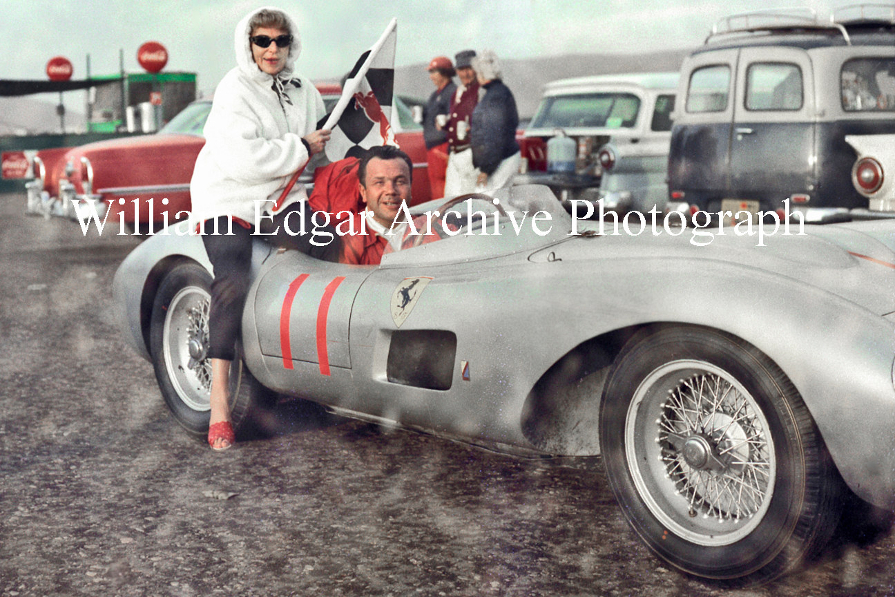 Photography [RI-JEHGR] John von Neumann and his wife Eleanor with their Ferrari 625TR, in the rain at Hourglass Field, California - October 20, 1957 by William Edgar