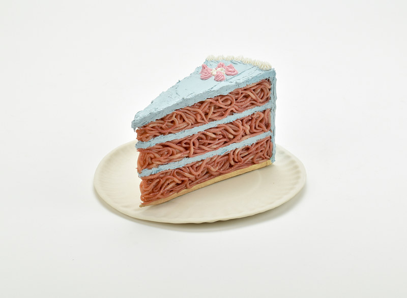 cake slice with blue icing on porcelain paper plate  by Matthew  Dercole