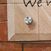 Redstone P.S. - Touchstone - Detail image of faux brick wall and glass plaque by Cindy Scaife