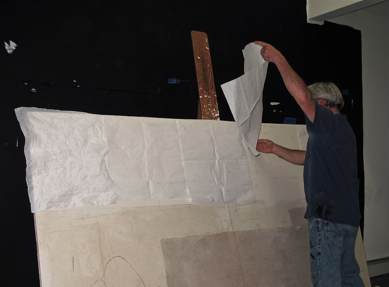 Putting down tissue paper layers onto I, II,III. (Flourtown, studio) by John Turner