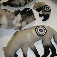 adding beaded targets to my wolves and bears by Belinda Harrow
