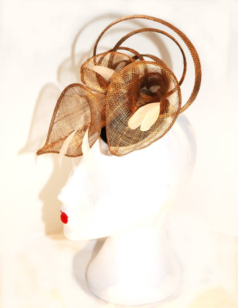 Gold arum lily headpiece with feather stamen by Fiona Menzies