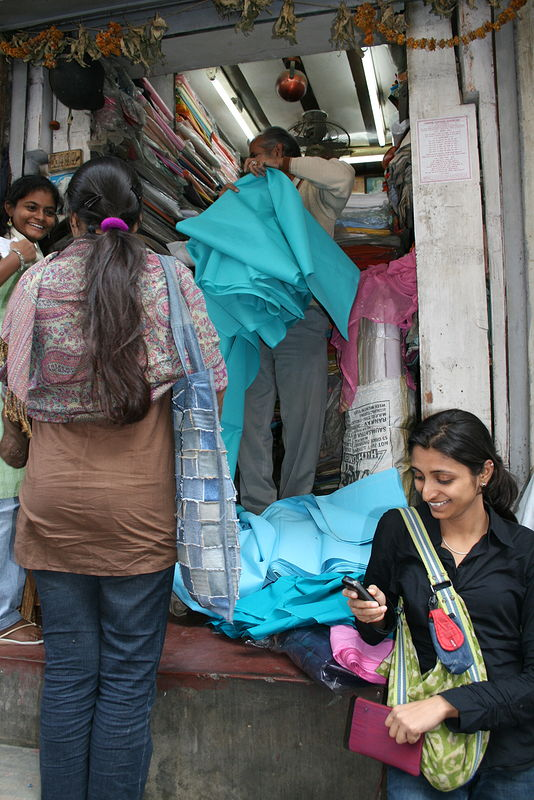 shopping for fabric in the markets with students by Belinda Harrow