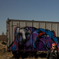 Painting Mural on C-Can at the Attawapiskat car dump by Sharon  Hunter
