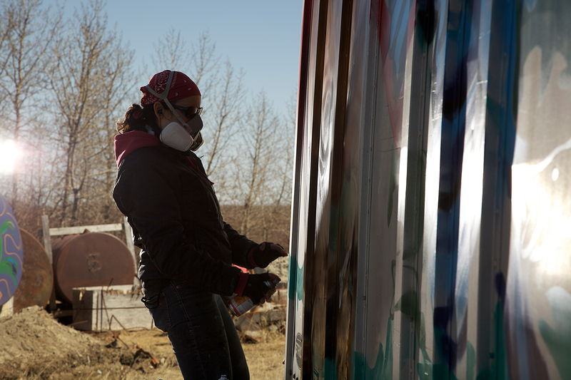 Process shots of paintings done at the Attawapiskat car dump by Sharon  Hunter