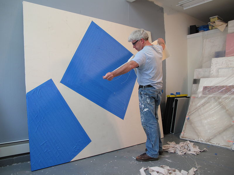 Ripping canvas strips, for 84 inch x 96 inch work. Flourtown, PA., studio. by John Turner