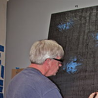 New 2013 series. Brushing on flat black under layer, to canvases. by John Turner