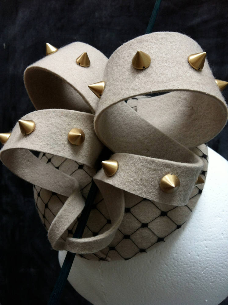 Studded beige cocktail hat by Fiona Menzies