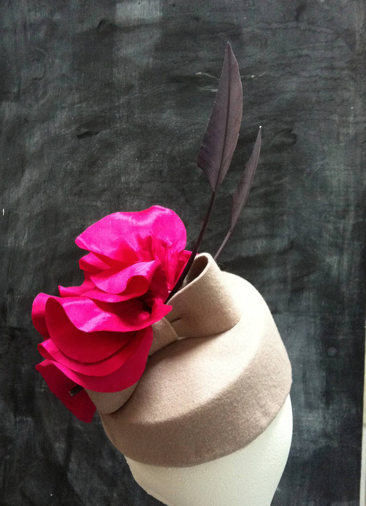 Blush percher with hot pink silk flower and arrowheads by Fiona Menzies