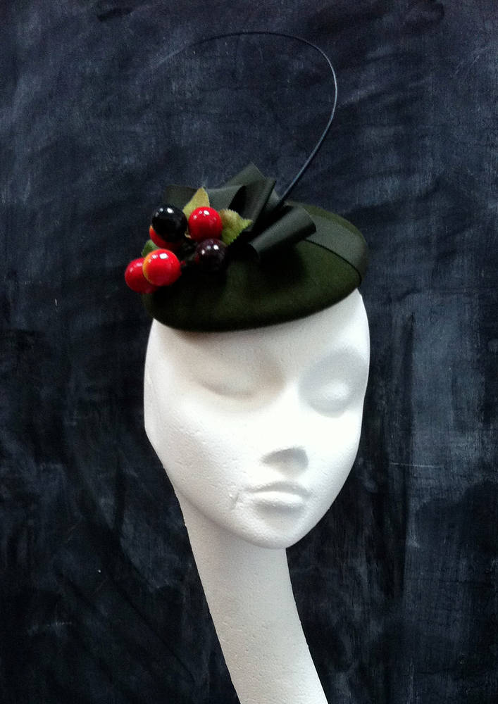 Cherry cocktail hat by Fiona Menzies