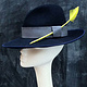 Navy fedora with yellow feather by Fiona Menzies