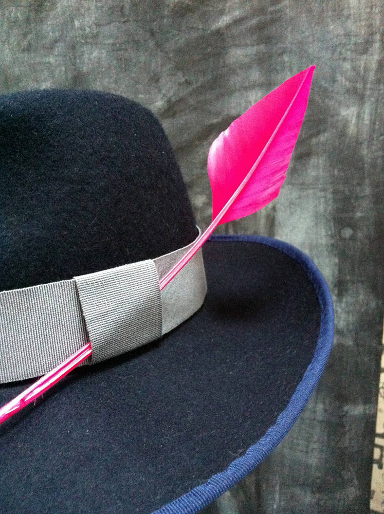 Navy fedora with cerise feather by Fiona Menzies