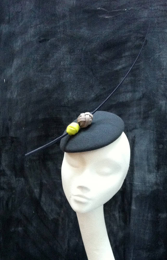 Grey and acid yellow cocktail hat by Fiona Menzies