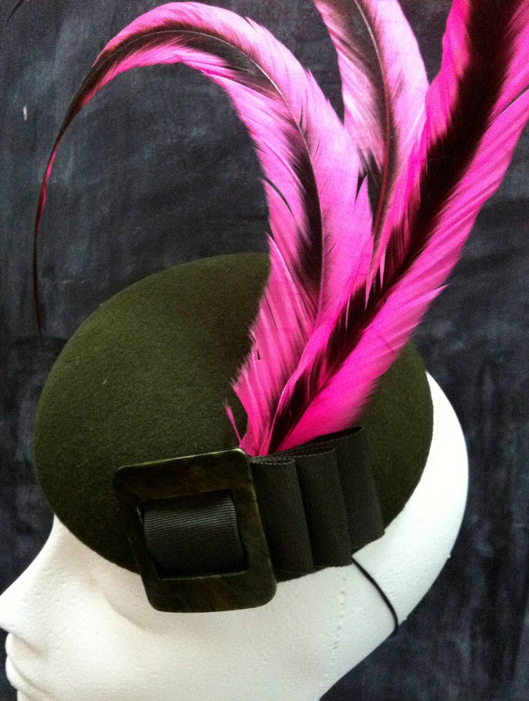 Pink feathered cocktail hat by Fiona Menzies