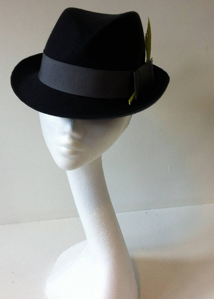 Charcoal trilby with acid yellow feather by Fiona Menzies