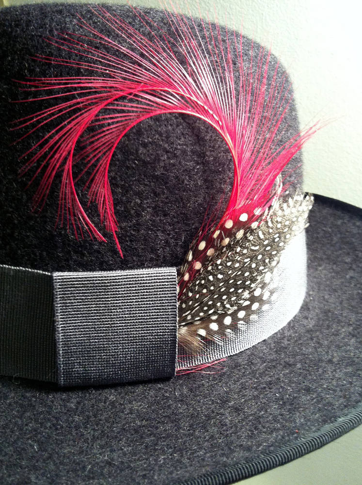 Charcoal fedora with grey trim & pink feather by Fiona Menzies