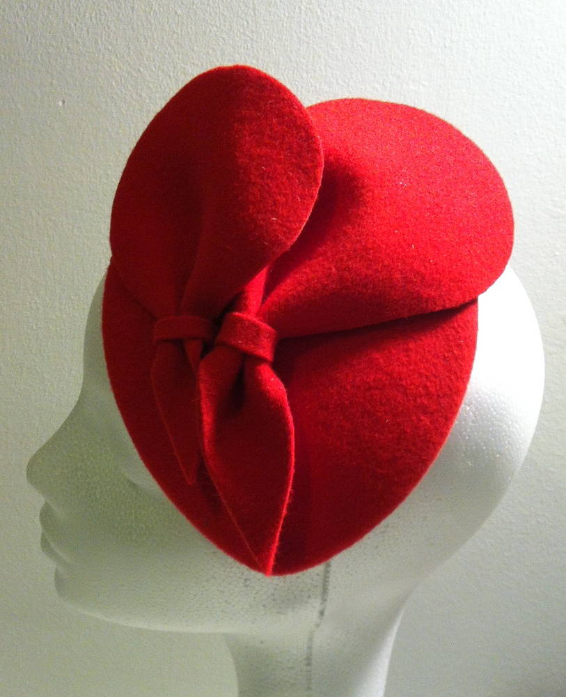 Poppy red cocktail hat by Fiona Menzies